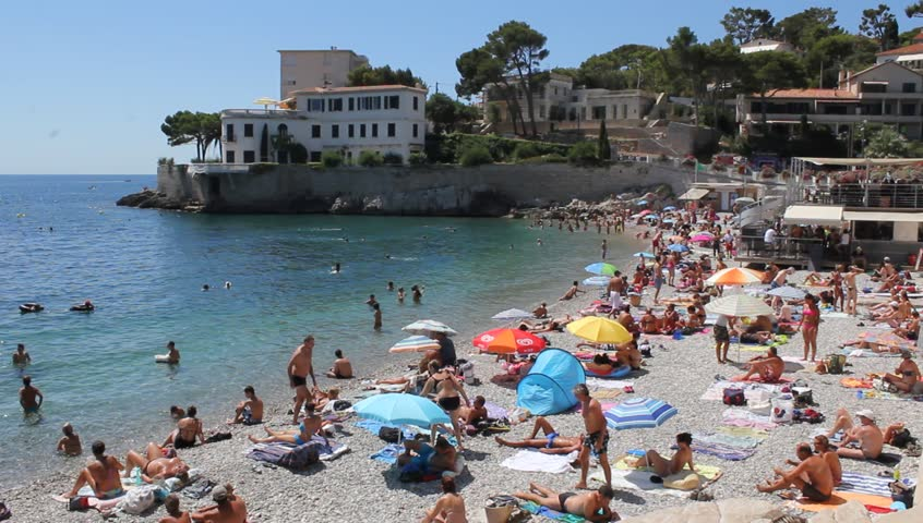 """CASSIS, FRANCE - AUGUST 22 : People chilling at """"Bestouan"""" beach in French Riviera on August 22nd 2013 in Cassis, France"""