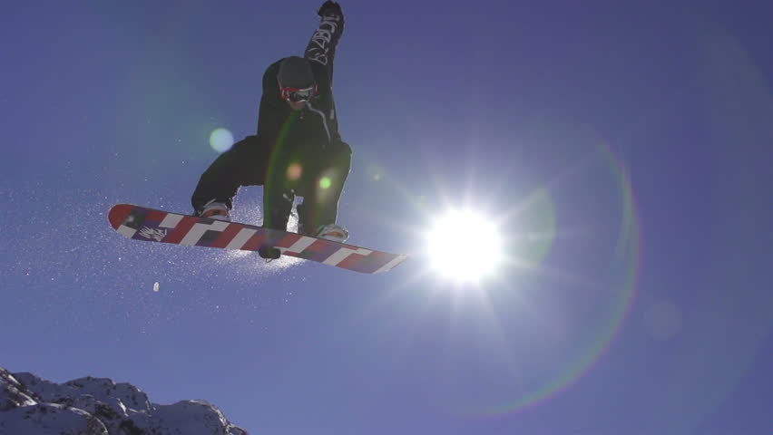 SLOW MOTION: Snowboarder jumps over the sun | Shutterstock HD Video #4514717