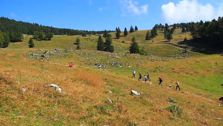 People on the mountain on sunny summer day. | Shutterstock HD Video #4531328