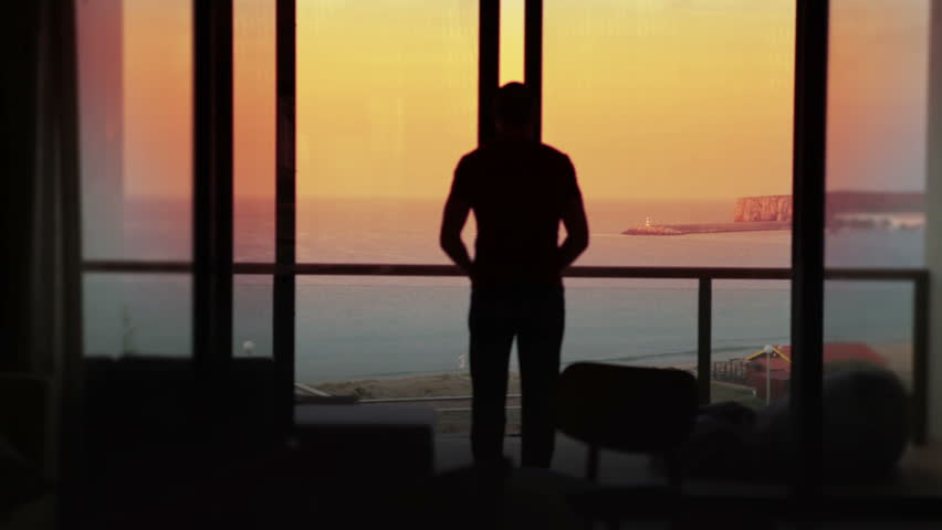Man opens the doors to his terrace on holiday. Summer vacation at sunset. | Shutterstock HD Video #4535705