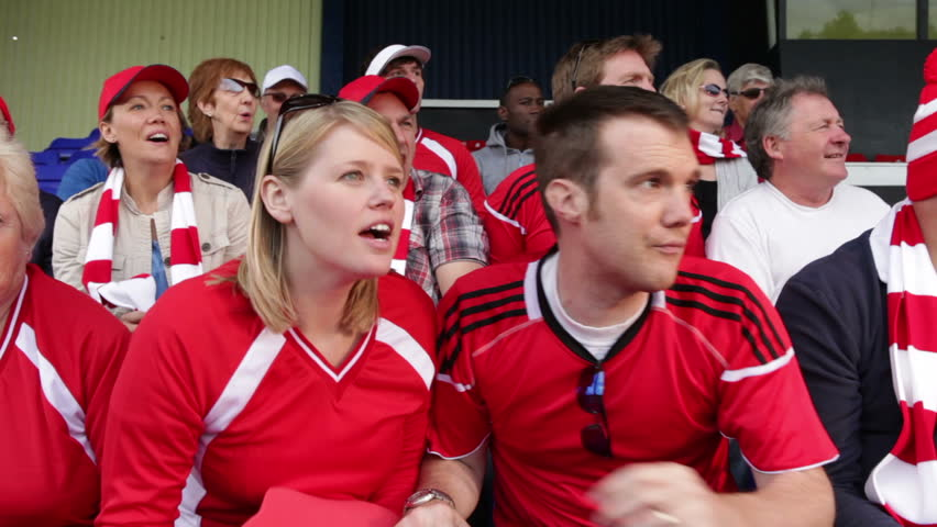 Enthusiastic crowd of spectators watching a sports game or football match and reacting    Shutterstock HD Video #4536248
