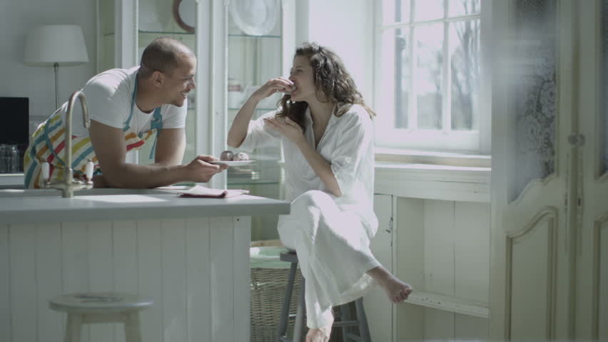 Loving husband or boyfriend offers a plate of freshly baked treats to his lover