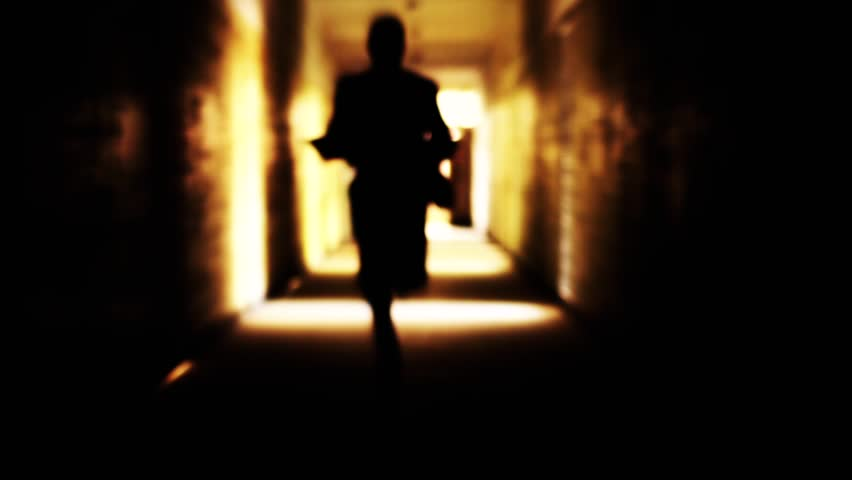Silhouette man running light in a tunnel escape freedom concept #4540919