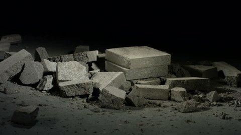 Sledge hammer hitting concrete bricks