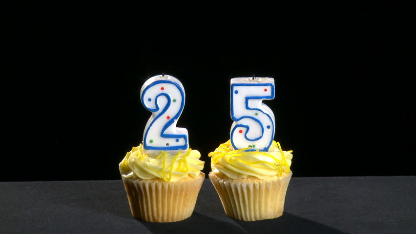 Two Cupcakes With The Number 2 And 5 On It Candles Are First Lit They Stay For A Few Seconds Then Blown Out