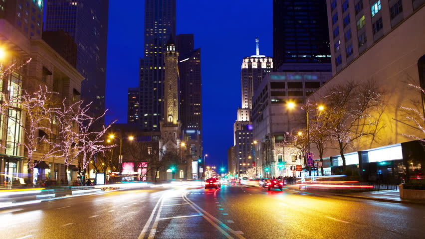 Michigan Avenue and Magnificent Mile with traffic at night timelapse, Chicago, IL, USA