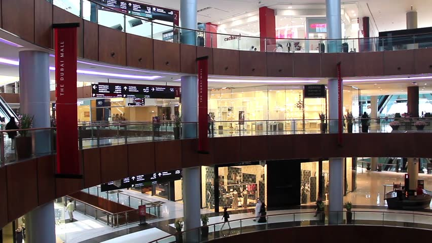 DUBAI, UAE, OCTOBER 16, 2011: People inside Dubai Mall. The Dubai Mall is the world's largest shopping mall based on total area and fifth largest by gross leasable area, UAE, October 16, 2011