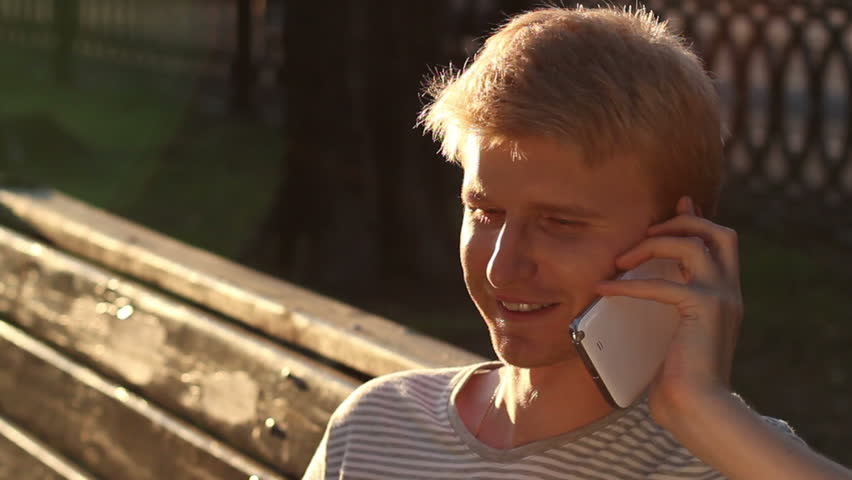 Happy young male calling over phone enjoying, good relationships