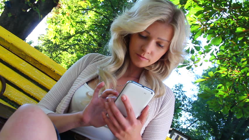 Businesswoman delivering news getting updates on touch phone