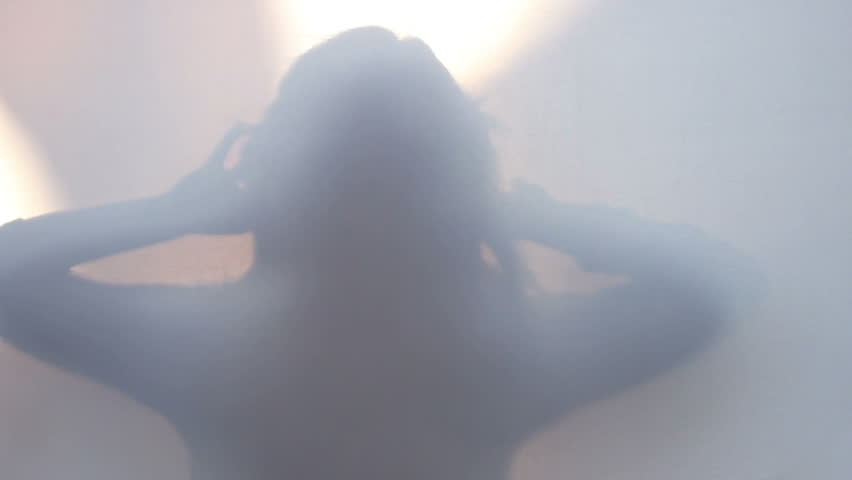 Slender slim silhouette of woman  moving turning touching hair