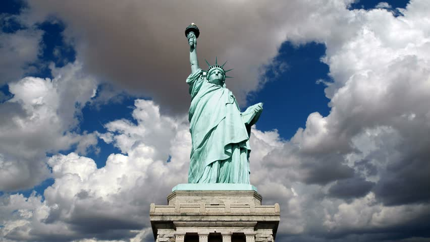 Statue of Liberty with time lapse clouds near New York City.   Shutterstock HD Video #4578548
