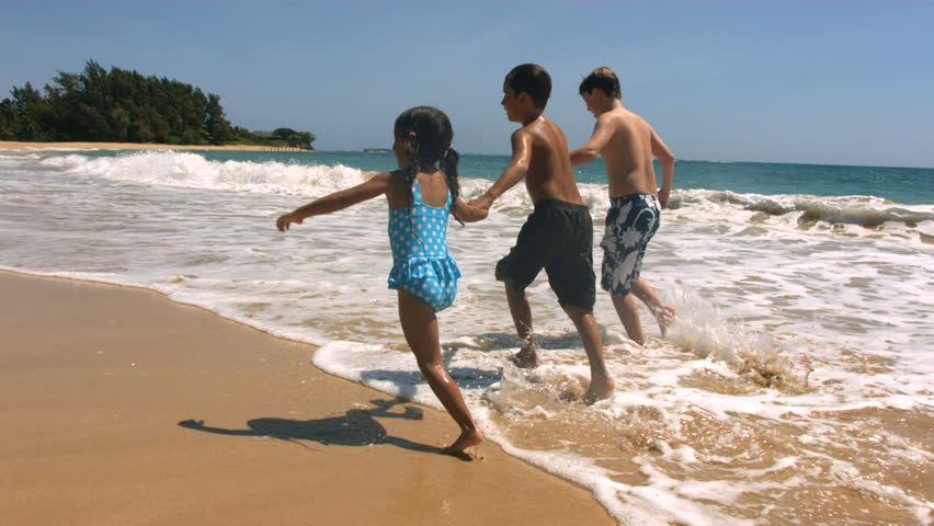 Three Kids Running Along Beach Together Slow Motion Stock Footage Video 4595438