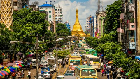 YANGON - AUG 13: Timelapse view of a busy street and market leading to the Sule Paya a major landmark of the downtown area of the city on 13 August 2013 in Yangon, Myanmar