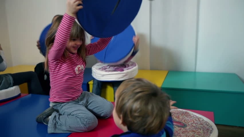 Kids playing in kindergarten with pillows | Shutterstock HD Video #4625201