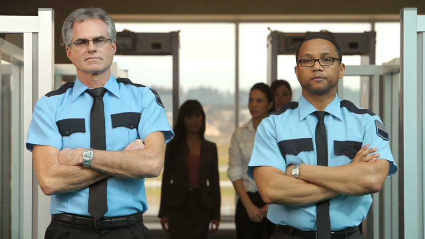 Portrait of two airport security guards