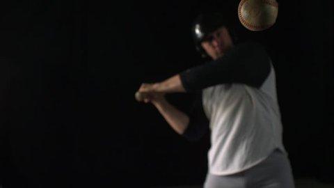 Baseball player hitting ball with bat shooting with high speed camera, phantom flex.
