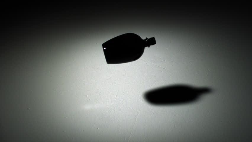 Droppingand smashing glass bottle of sand shooting with high speed camera, phantom flex.