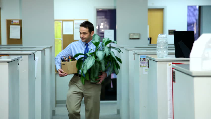 Employee leaves the office after being fired  | Shutterstock HD Video #4634540