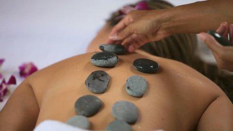 Hot stone spa treatment, closeup