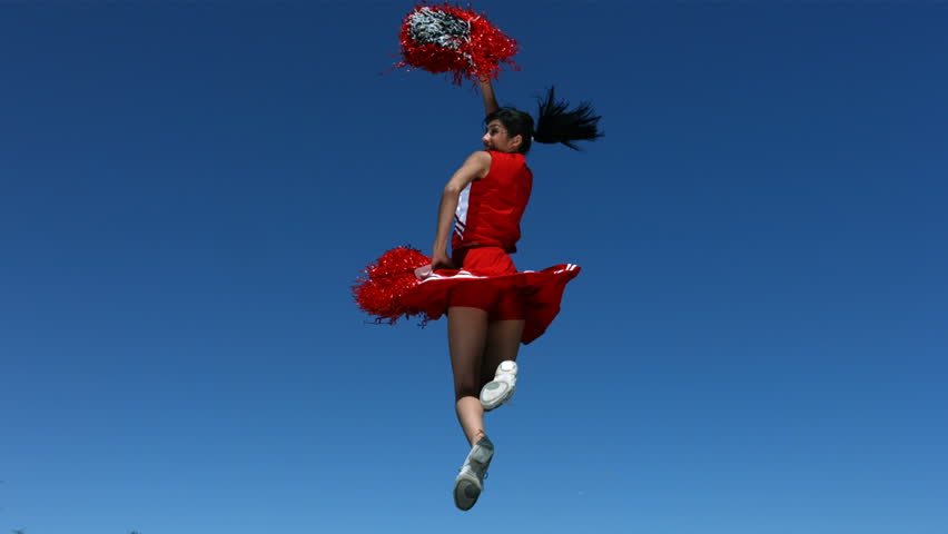 Cheerleader jumping in the air, slow motion