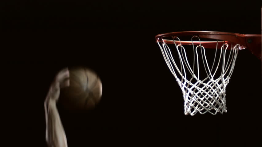 Close up of a basketball dunk.