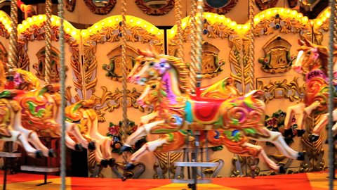 Amusement park carousel with beautifully painted wooden horses, London, United Kingdom