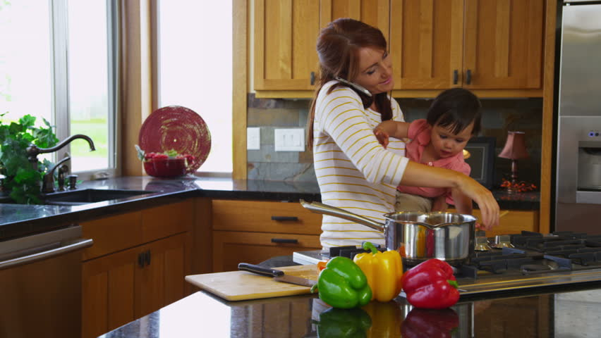 Mother in Kitchen with Young Stock Footage Video (100% Royalty-free)  4665068 | Shutterstock