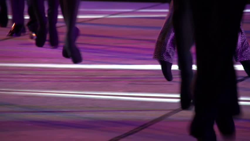 Ballet Catwalk. Ballet dancers in black pointes randomly moving around the stage on his toes
