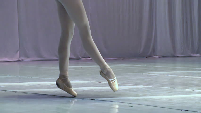 Dance of the Ballerina. Ballerina shows classic ballet pas. Slow Motion at a rate of 240 fps