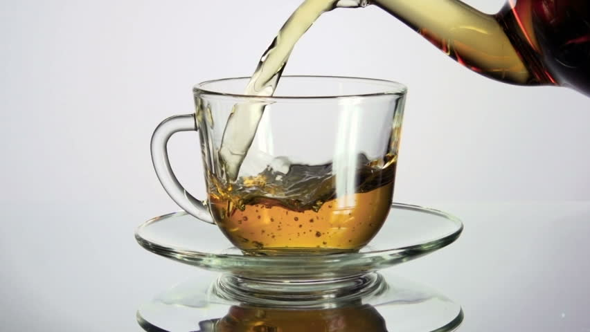 Tea being poured into glass tea cup