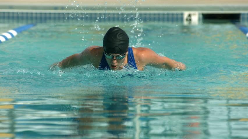 Swimmer doing butterfly stroke, super slow motion #4686812