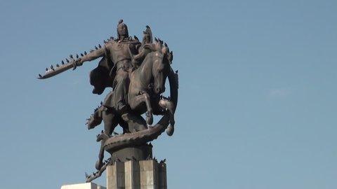 Birds take a rest at the Manas statue in Bishkek, Kyrgyzstan