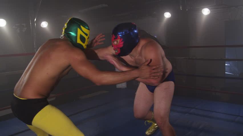 Masked wrestler spins opponent on shoulders