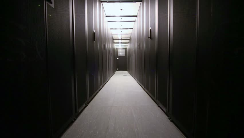 Light switched off and then turns on in corridor sealed with racks for equipment of telecommunication system