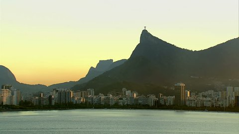 Low angle aerial of Christ the Redeemer and beach at sunset, Rio de Janeiro, Brazil