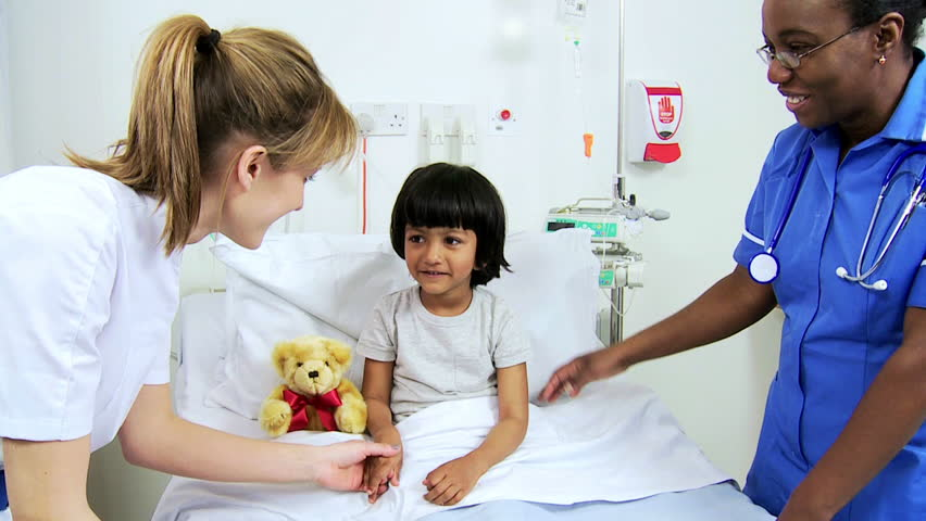 Young Pediatric Patient Being Comforted By A Dedicated Multi-ethnic ...