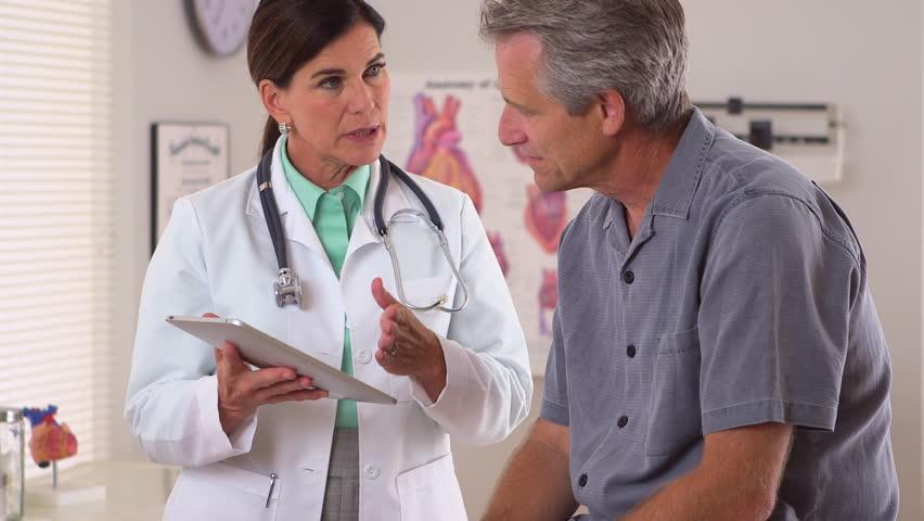 Doctor sharing patient's upcoming medical procedures | Shutterstock HD Video #4781951