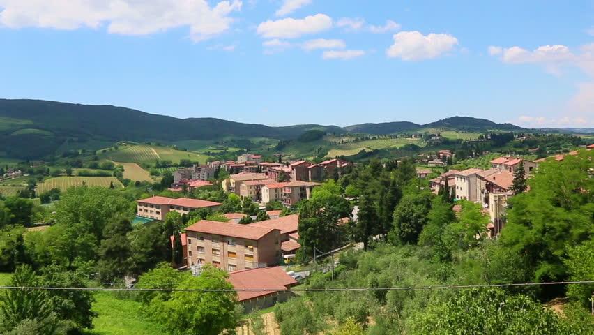 Tilt up shot of houses on a hill, San Gimignano, Province Of Siena, Tuscany, Italy
