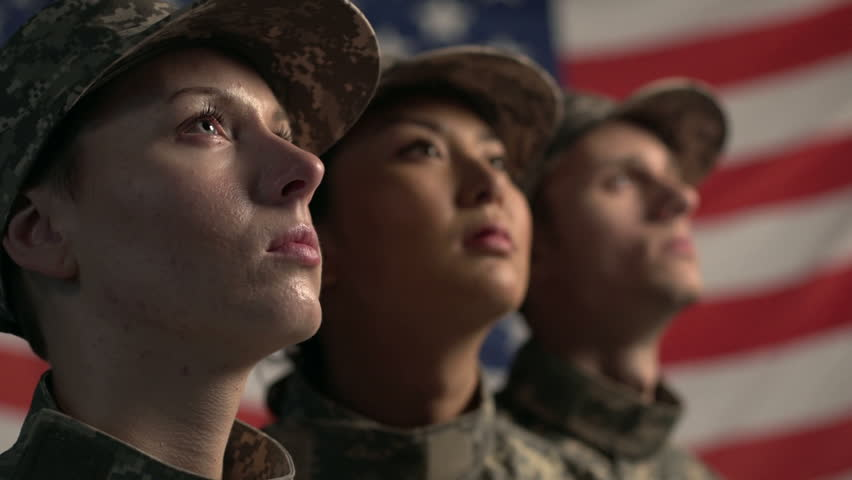 3 soldiers in front of American Flag Close Up #4830398