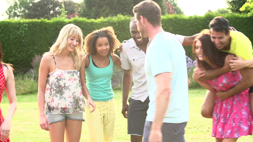 Slow Motion Sequence Of Young Adult Friends Dancing And Having Fun In Summer Garden