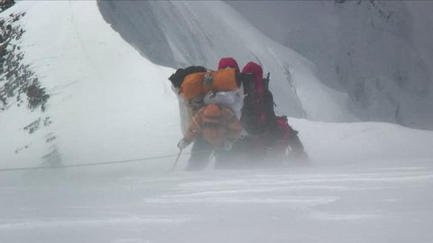 Climbers battered by strong winds