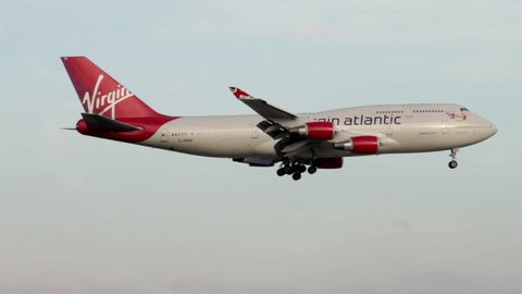 MANCHESTER, LANCASHIRE/ENGLAND - SEPTEMBER 29: Virgin Atlantic Boeing 747 comes in to land on September 29, 2013 in Manchester. Virgin Atlantic is owned by Sir Richard Branson's Virgin Group.