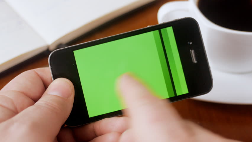 Man looking through green screen pages on smartphone #4886918