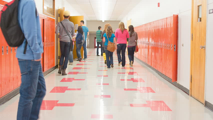 A busy school hallway with students walking to and from class | Shutterstock HD Video #4893608
