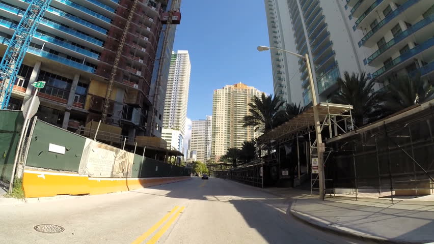 MIAMI - OCTOBER 11: Drivers pov vehicle driving along the streets of Brickell Miami October 11, 2013 in Miami, USA. Brickell is Miami's major financial district.  | Shutterstock HD Video #4905239