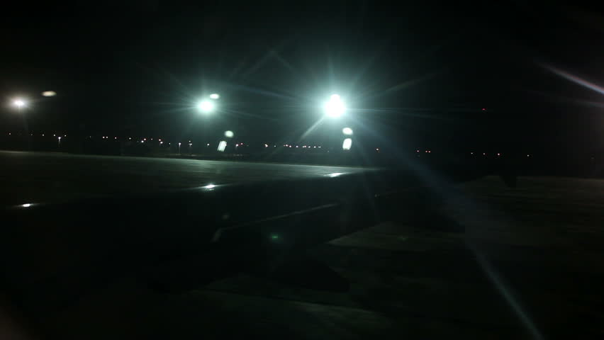 Airplane wing from inside while at airport at night | Shutterstock HD Video #4910138