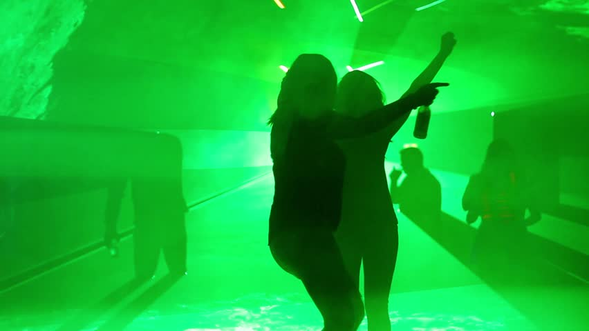 Silhouetted Girl Dancing in Nightclub - Flashing Lights and Lasers