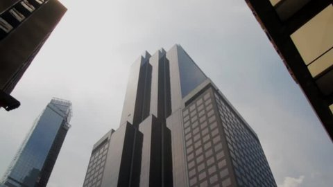 New York, NY - July 2013 - Manhattan exterior office building midtown. tilt down. tilt up.