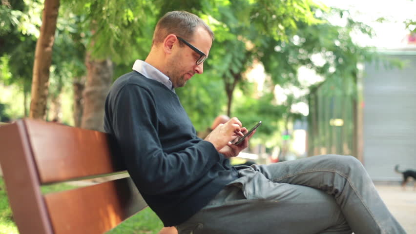 Young man with tablet computer in the city