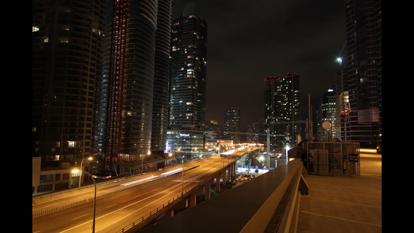 Toronto highway at night. Timelapse. Timelapse of Gardiner expressway at night in downtown Toronto. Looking east. Clip is assembled from hi-res stills taken with a Canon 550D camera.